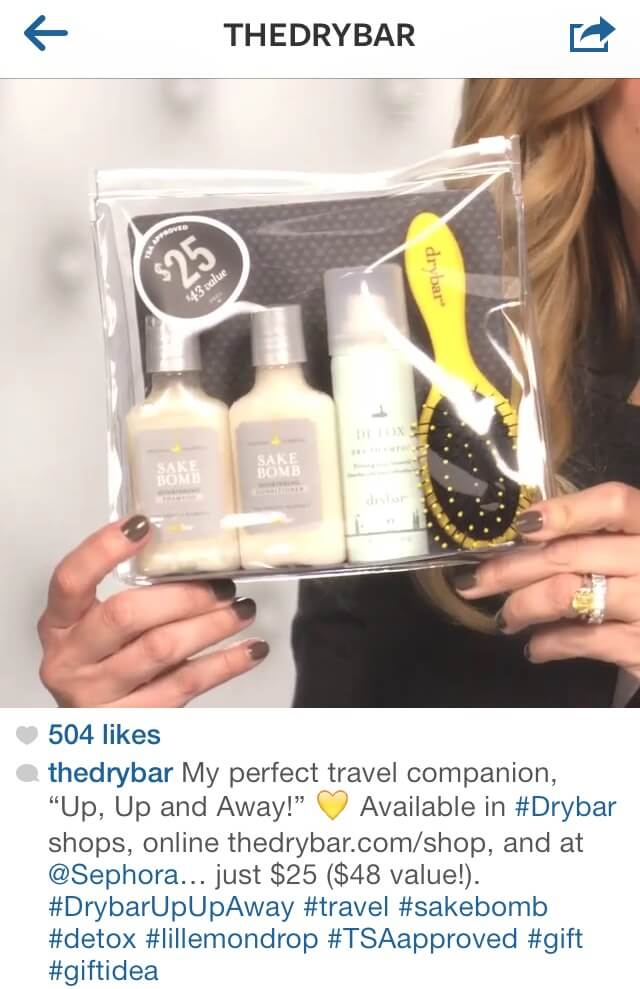 5a331d02c Instagram post from Drybar plus caption and hashtag featuring a travel set  of hair products.