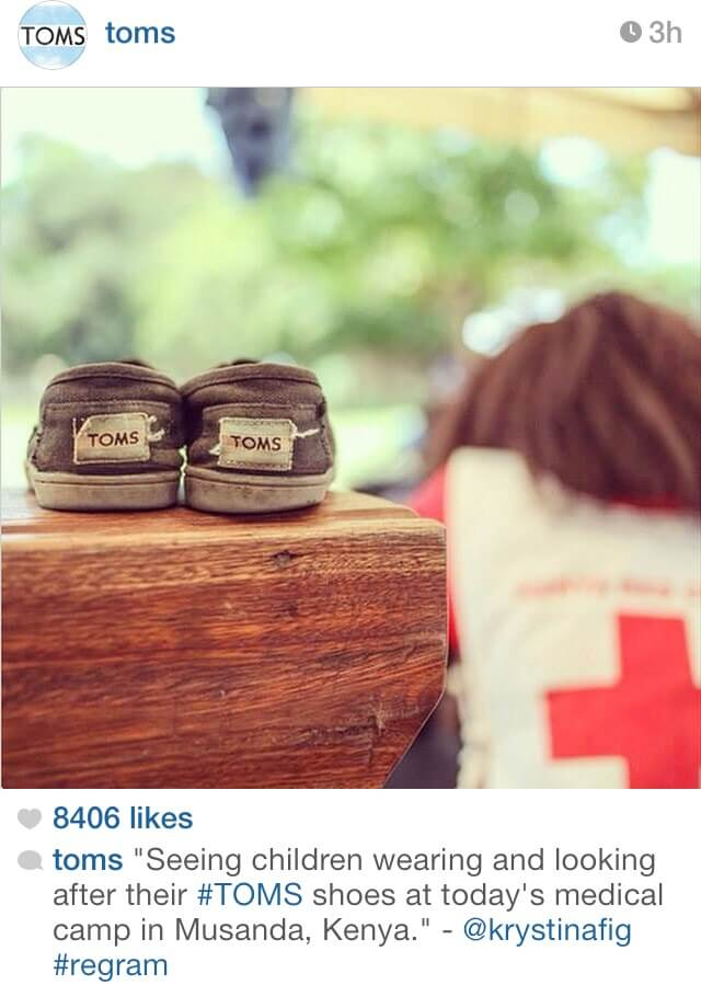 Old pair of TOMS shoes with a Red Cross bag in the background in Kenya.