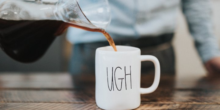 """Coffee being poured into a mug that reads """"Ugh"""""""