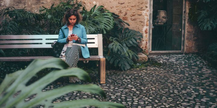 Woman sitting on an outdoor bench