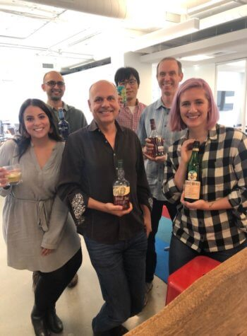 Rival IQ team holding all the alcohol brands profiled in this report